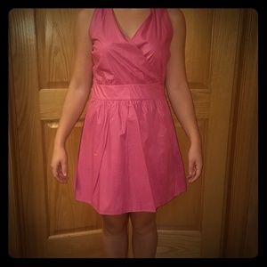 Peek a boo back pink wrap dress with bow detail